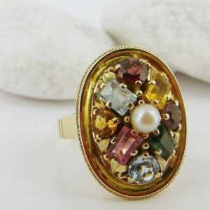 Ring mit einer Akoya Zuchtperle und Beryllbesatz in 585/- Gelbgold!