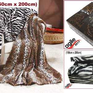 Elegante Wohndecke aus geprägtem Microfaser-Fell im Zebra o Leo.